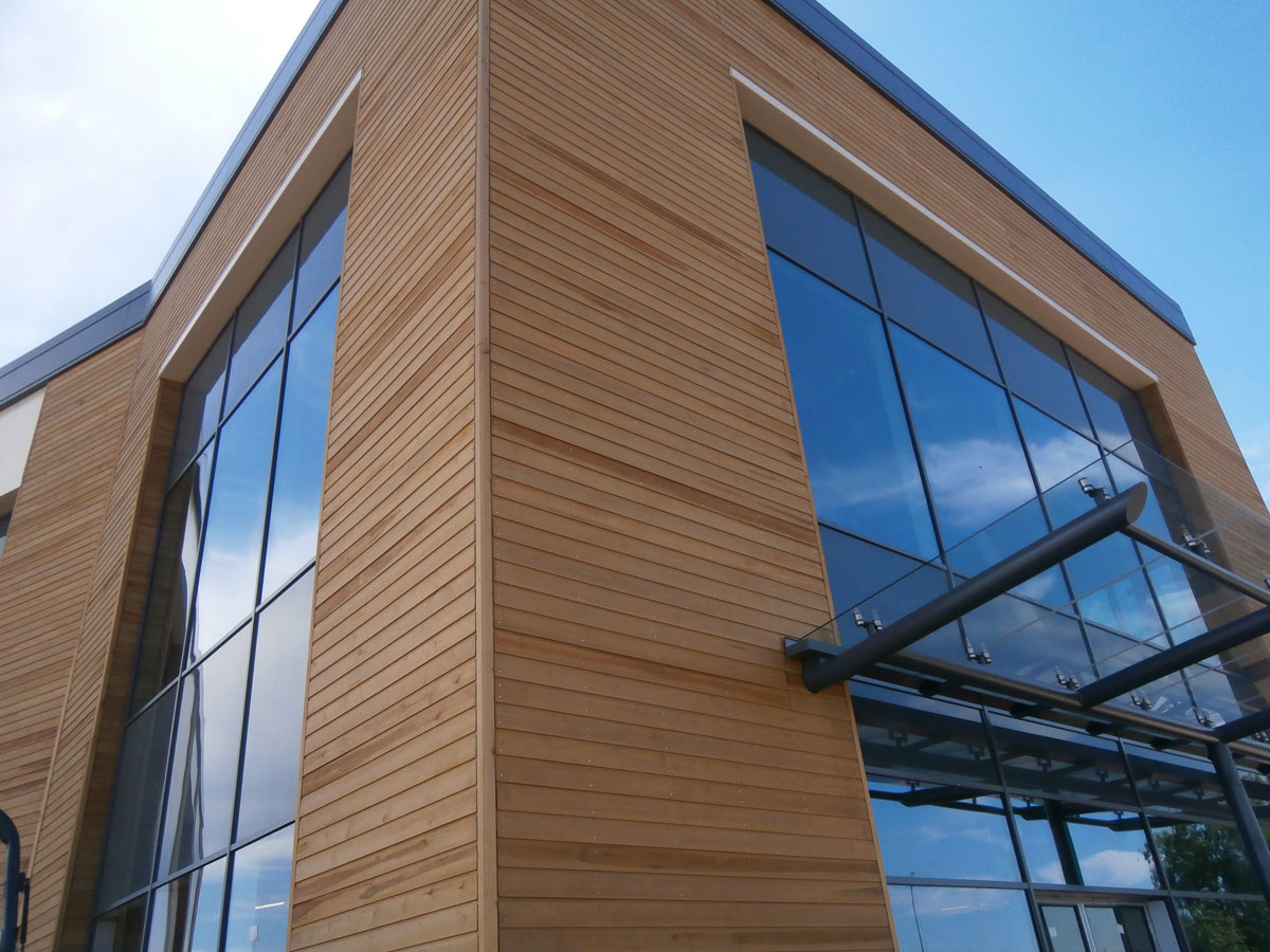 Commercial Wood Cladding ~ Norclad timber cladding solutions gallery retail and